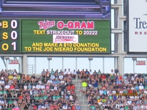 The Twins-O'Gram Board promoting the Text to Give